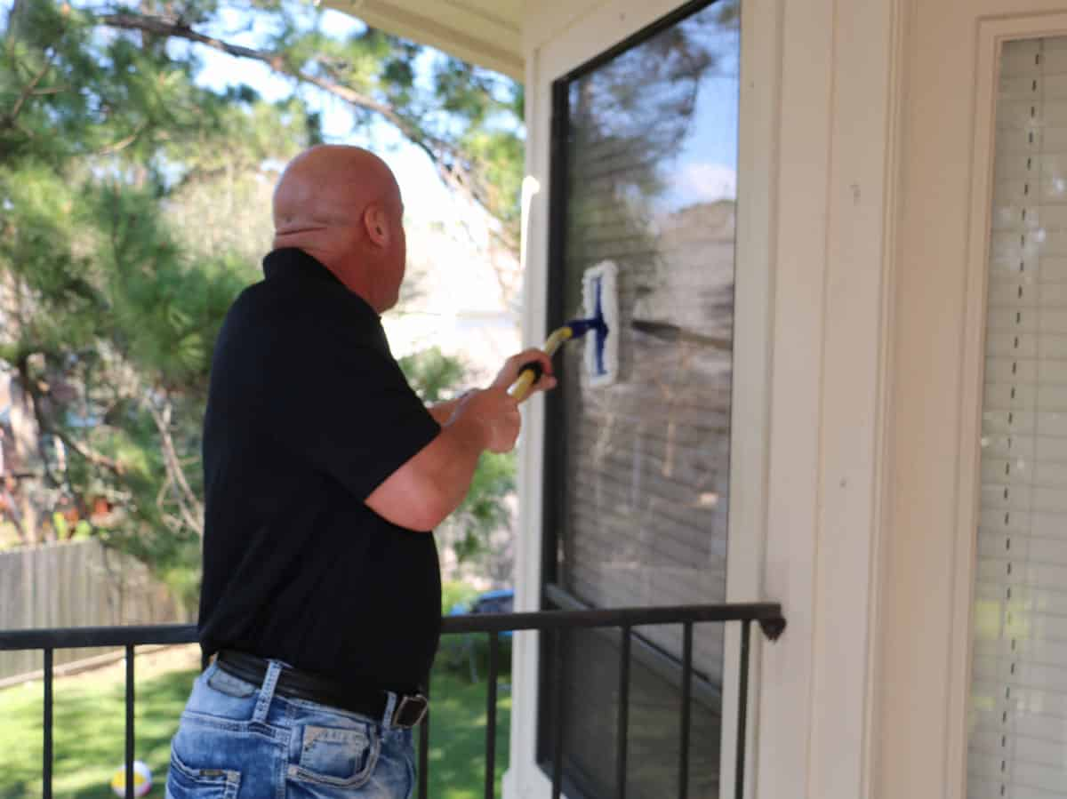 Man cleaning windows with The Simple Scrub Original.